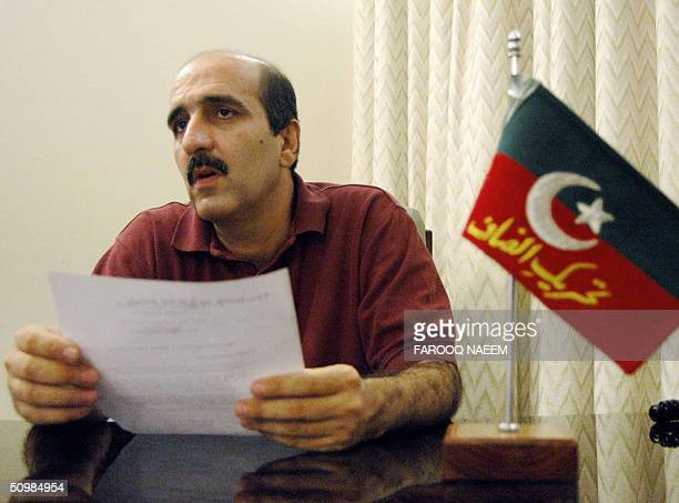 Central Information Secretary of Pakistan's Tehreeki Insaaf political party Akbar Babar reads a statment announcing the divorce of party chief Imran...