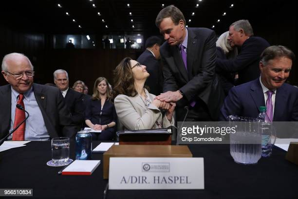 Central Intelligence Agency acting Director Gina Haspel shakes hands with Senate Intelligence Committee ranking member Sen Mark Warner before her...
