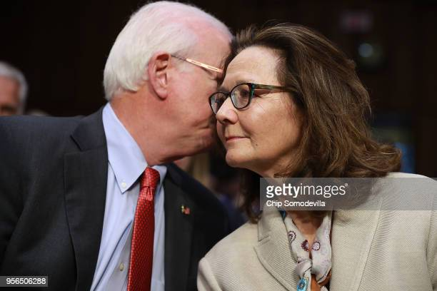 Central Intelligence Agency acting Director Gina Haspel talks with former Sen Saxby Chambliss during her confirmation hearing to become the next CIA...