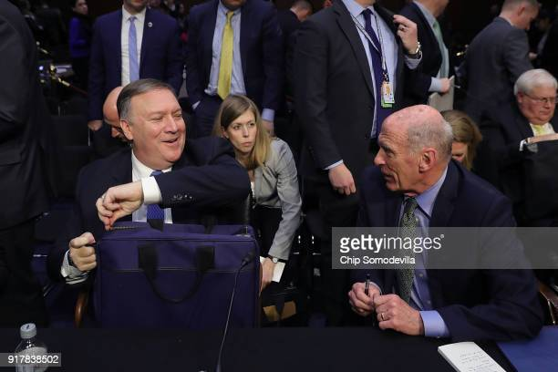 Central Intelligence Agency Director Mike Pompeo and Director of National Intelligence Dan Coats talk following an open hearing of the Senate...