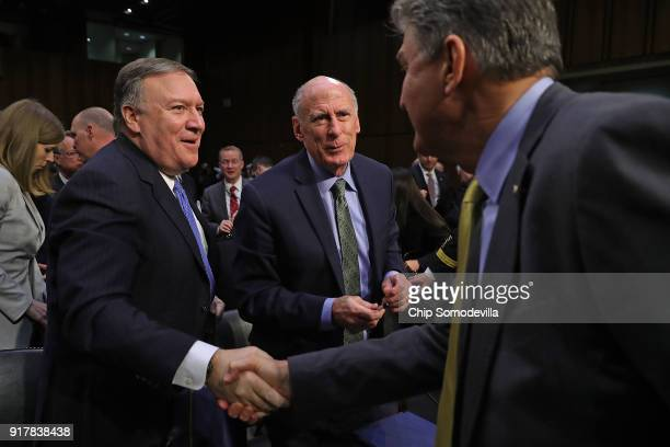 Central Intelligence Agency Director Mike Pompeo shakes hands with Senate Intelligence Committee member Sen Joe Manchin as Director of National...