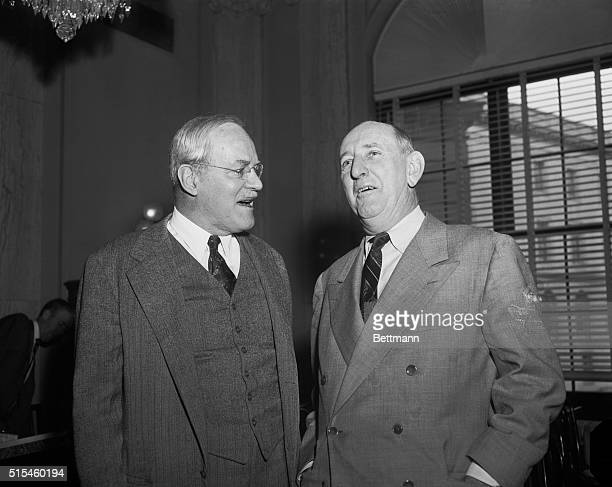 Central Intelligence Chief Allen W Dulles left confers with Senate Armed Services Chairman Richard Russell Georgia shortly before giving an...
