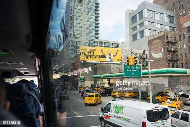 central intelligence movie billboard in new york city - lincoln tunnel stock photos and pictures