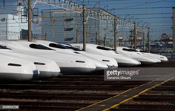 Central Japan Railway Co Shinkansen bullet trains sit parked at a train yard on January 19 2016 in Tokyo Japan Japanese rollingstock manufacturers...