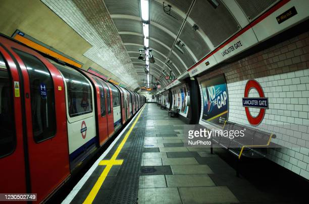 Central line tube train prepares to pull off from an empty platform at Lancaster Gate Station on the London Underground network in London, England,...
