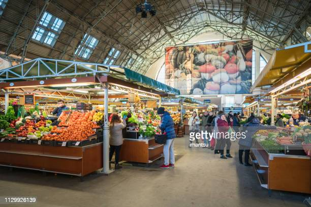 central market of riga, vegetable section - riga stock pictures, royalty-free photos & images