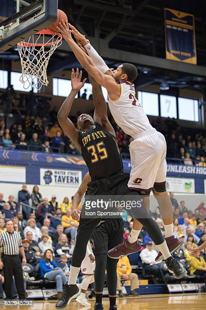 Central Michigan Chippewas F Blake Hibbitts misses on a slam as Kent State Golden Flashes F Jimmy Hall defends during the first half of the college...