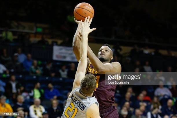 Central Michigan Chippewas forward Cecil Williams shoots over Toledo Rockets guard Dylan Alderson during a regular season MidAmerican Conference game...