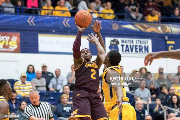 Central Michigan Chippewas G Braylon Rayson shoots as Kent State Golden Flashes G Deon Edwin defends during the first half of the MAC men's...