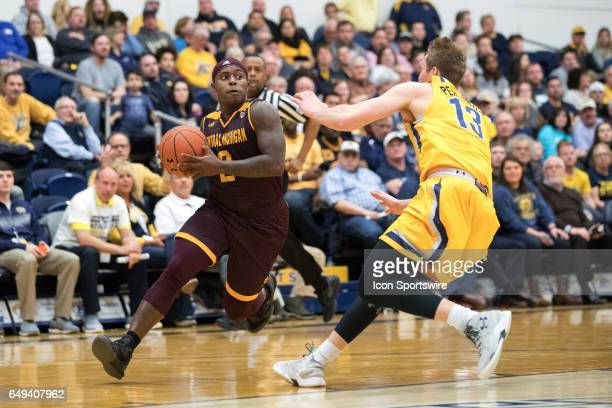 Central Michigan Chippewas G Marcus Keene drives to the basket as Kent State Golden Flashes G Mitch Peterson defends during the first half of the MAC...