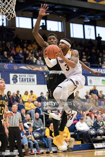 Central Michigan Chippewas G Marcus Keene drives to the basket against Kent State Golden Flashes F Danny Pippen during the first half of the college...