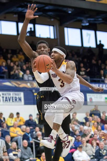Central Michigan Chippewas G Marcus Keene goes up for a shot as Kent State Golden Flashes F Danny Pippen defends during the first half of the men's...