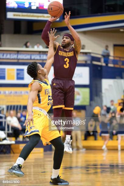 Central Michigan Chippewas G Marcus Keene shoots over Kent State Golden Flashes G Kevin Zabo during the first half of the MAC men's basketball...