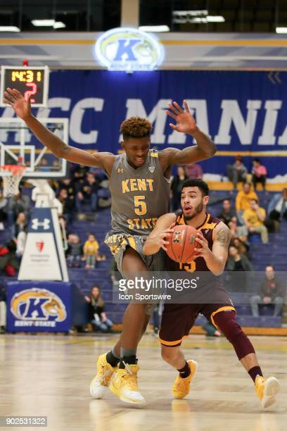 Central Michigan Chippewas guard Matty Smith is called for traveling as Kent State Golden Flashes forward Danny Pippen applies defensive pressure...