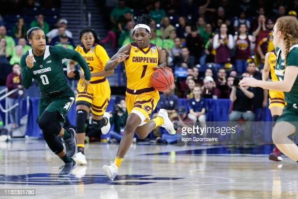 Central Michigan Chippewas guard Micaela Kelly brings the ball up the court while being defended by Michigan State Spartans guard Shay Colley during...