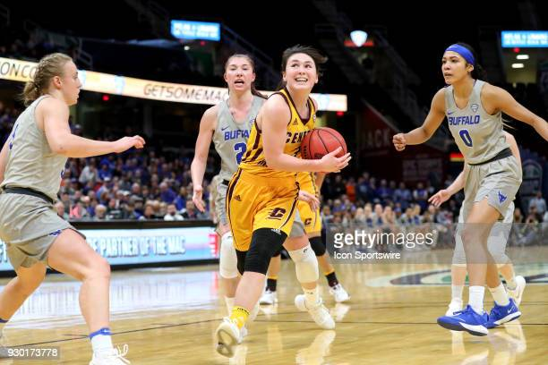 Central Michigan Chippewas guard Presley Hudson drives to the basket thru Buffalo Bulls guard Katherine Ups Buffalo Bulls forward Mariah Suchan and...