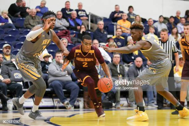 Central Michigan Chippewas guard Shawn Roundtree Jr drives to the basket as Kent State Golden Flashes center Adonis De La Rosa and Kent State Golden...