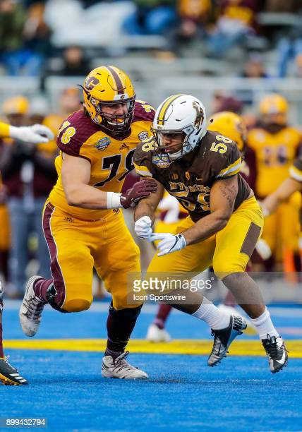 Central Michigan Chippewas offensive lineman Clay Walderzak blocking against Wyoming Cowboys defensive end Taniela Lolohea during Famous Idaho Potato...