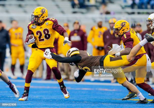 Central Michigan Chippewas running back Jerrod Davis spins away from Wyoming Cowboys linebacker Adam Pilapil during Famous Idaho Potato Bowl...