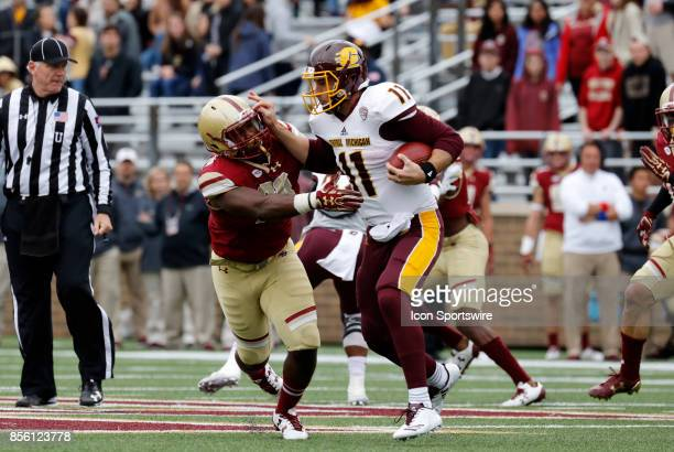 Central Michigan quarterback Shane Morris stiff arms Boston College defensive lineman Jack Kenny during a game between the Boston College Eagles and...