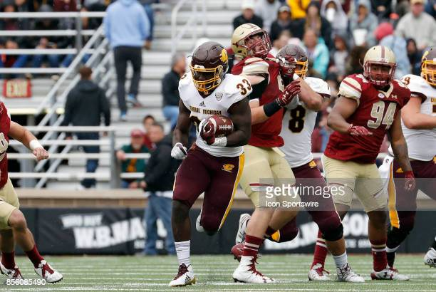 Central Michigan running back Kumehnnu Gwilly breaks through the line during a game between the Boston College Eagles and the Central Michigan...