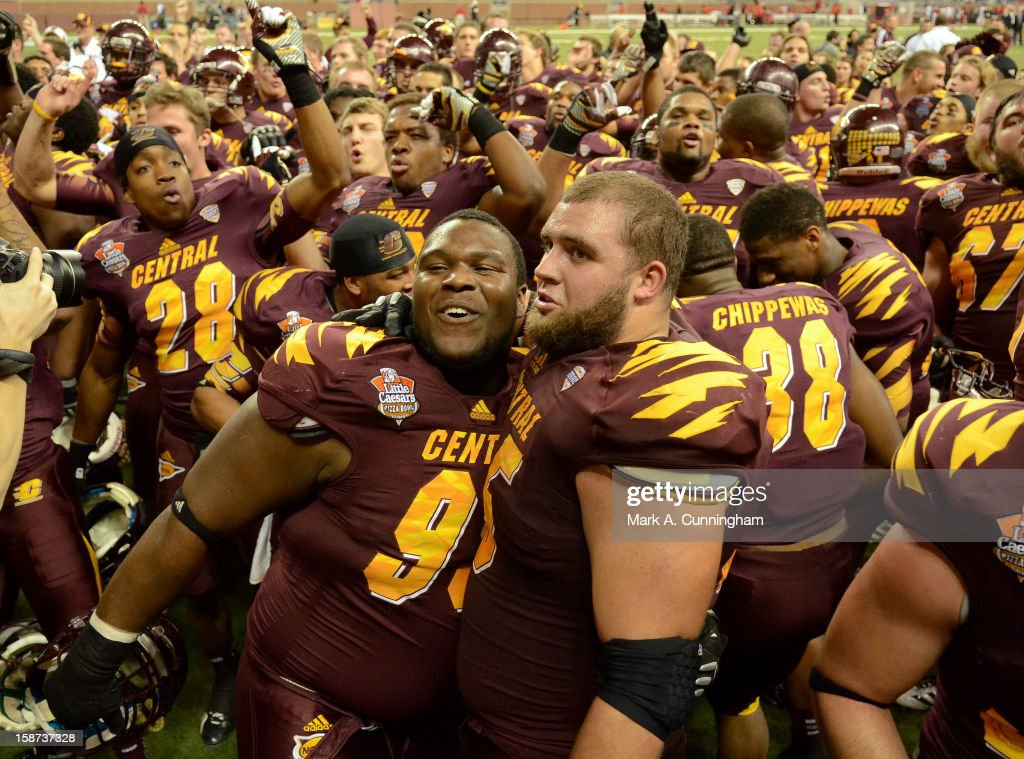 Central Michigan University Chippewas players celebrate after the victory against the Western Kentucky University Hilltoppers in the Little Caesars Pizza Bowl at Ford Field on December 26, 2012 in Detroit, Michigan. The Chippewas defeated the Hilltoppers 24-21.