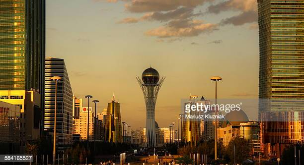 central modern astana and bayterek tower sunset - kazakhstan stock pictures, royalty-free photos & images