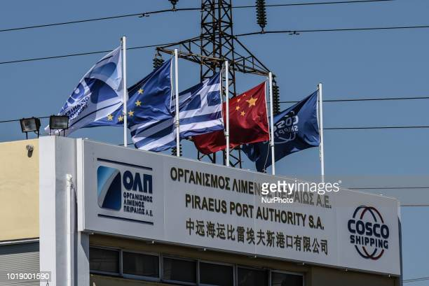 Central offices of Piraeus Port Authority with flags Piraeus Container Terminal operated by COSCO in Piraeus, Greece on August 13, 2018.