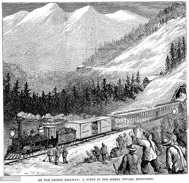 Central Pacific Railraod in the Sierra Nevada mountains Train cheered by railroad workers including Chinese labourers Wood engraving c1875