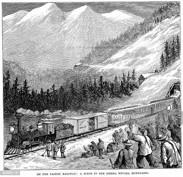 Central Pacific Railroad in the Sierra Nevada mountains Train cheered by railroad workers including Chinese labourers c1875Wood engraving