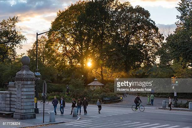 Central Park entrance during sunset Central Park is an urban park in middleupper Manhattan Central Park is the most visited urban park in the United...