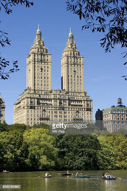 Central Park, New York City in Summer at The Lake with Central Park West Skyline and the Dakota Apartments. Central Park. There are several places in...