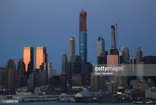 Central Park Tower rises on the Manhattan skyline next to the Time Warner Center in New York City on April 6, 2019 as seen from Weehawken, New Jersey.