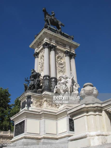 Central part of the sculpture dedicated to King Alfonso XII in the pond of Retiro Park, Madrid, september 2010.