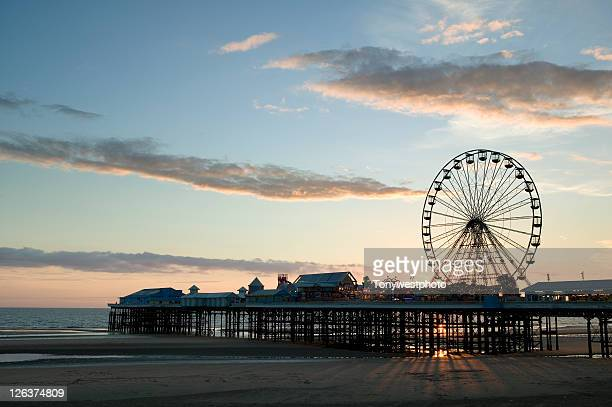 central pier at blackpool, in silhouette against the setting sun, in england's north east - north stock pictures, royalty-free photos & images