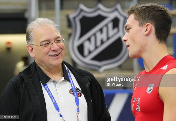 Central Scouting Director Dan Marr speaks with Shane Bowers during the NHL Combine at HarborCenter on June 3 2017 in Buffalo New York
