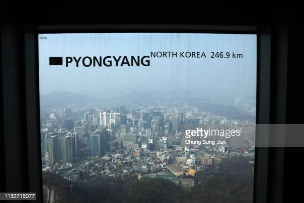 Central Seoul is seen through a window bearing the distance between North Korea's Pyongyang and Seoul at the N Seoul Tower on February 28 2019 in...