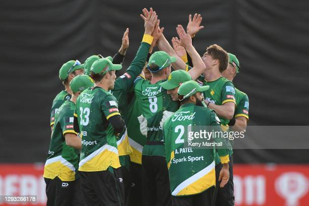 Central Stags players celebrate a wicket during the Super Smash T20 match between the Central Stags and the Wellington Firebirds at McLean Park on...