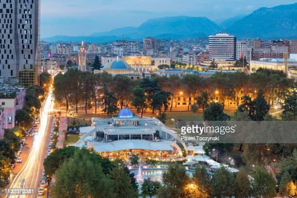 central tirana's park rinia at sunset, tirana, albania, 2018 - socialism stock pictures, royalty-free photos & images