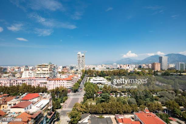 central tirana's park rinia with the unfinished 4 ever green tower, albania, 2018 - socialism stock pictures, royalty-free photos & images