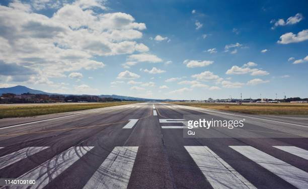 central view of runway at rome (ciampino) airport , italy - airport runway stock pictures, royalty-free photos & images