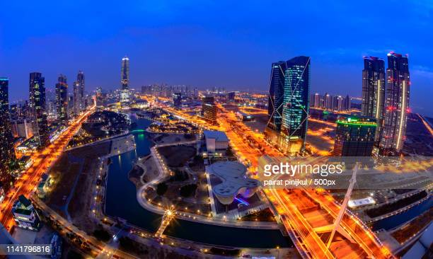 centralpark at night incheon, south korea - songdo ibd stock pictures, royalty-free photos & images