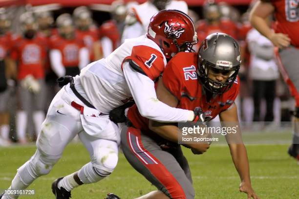 CentralPhenix City Wallace Melton sacks Thompson quarterback Taulia Tagovailoa during the Alabama 7A State Championship game between Thompson and...
