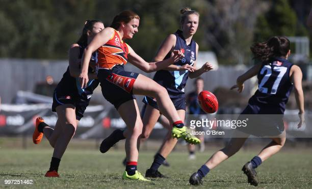 Central's Amber Ward gets a kick away during the AFLW U18 Championships match between Vic Metro v Central Allies at Bond University on July 13 2018...