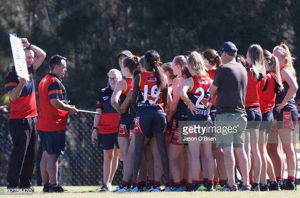 Central's Jimmy Driscoll addresses his team during the AFLW U18 Championships match between Vic Metro v Central Allies at Bond University on July 13...