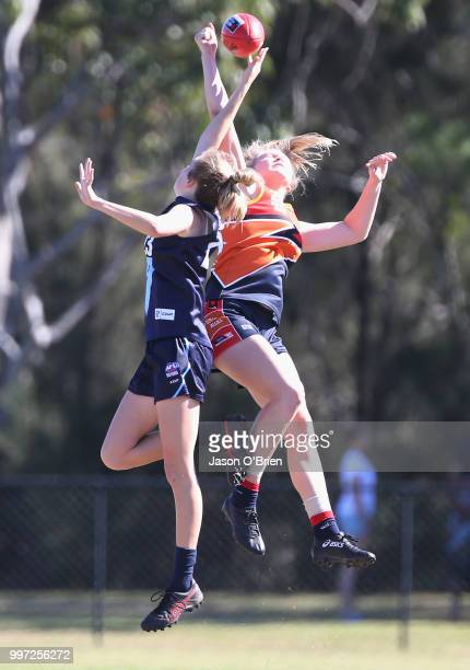 Central's Montana Mckinnon contests posession with Vic Metro's Sarah Kendall during the AFLW U18 Championships match between Vic Metro v Central...