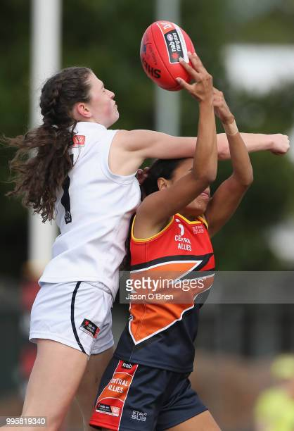 Central's Tabitha May contests the ball with Vic Country's Shelley Heath during the AFLW U18 Championships match between Vic Country and Central...