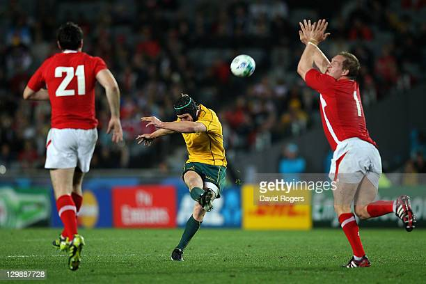 Centre Berrick Barnes of the Wallabies kicks a drop goal during the 2011 IRB Rugby World Cup bronze final match between Wales and Australia at Eden...