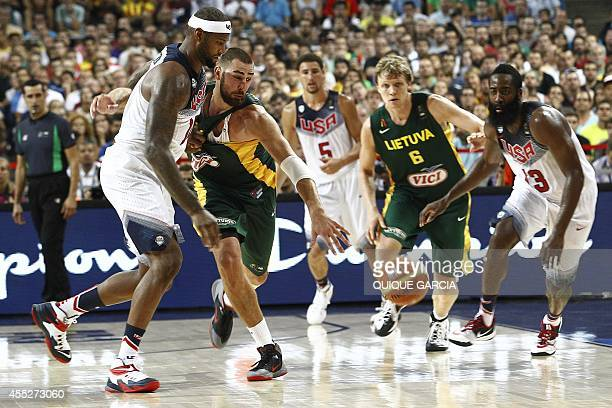 US centre DeMarcus Cousins vies with Lithuania's centre Jonas Valanciunas during the 2014 FIBA World basketball championships semifinal match...