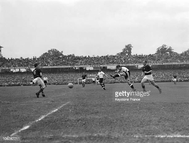 Centre forward Fritz Walter West Germany shoots beside the Gyula Lorant of Hungary during the match on July 4 1954 in Bern Switzerland